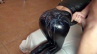 Brunette alexandra and sniny black latex leggings