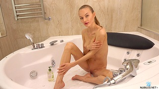 Charming amateur Jolie A teases and masturbates in the jacuzzi