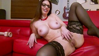 Busty wife Mindi Mink with glasses moans while inserting toys