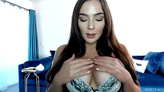 Webcam model Blair Williams is playing with her sex toys on a blue couch
