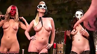 A group of hot dominas who are wearing masks and slutty lingerie